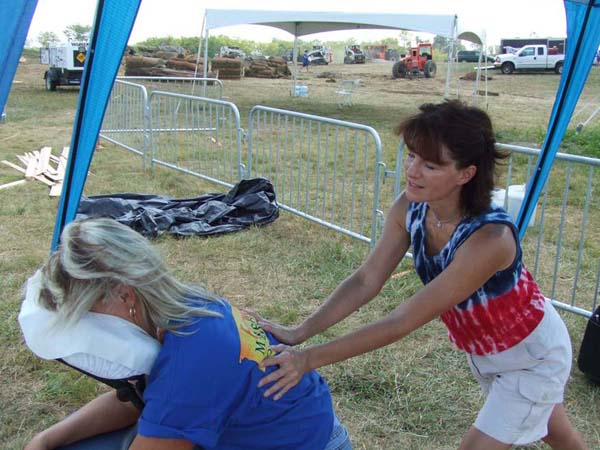 Paula Hawley provides chair massage for Extreme Home Makeover